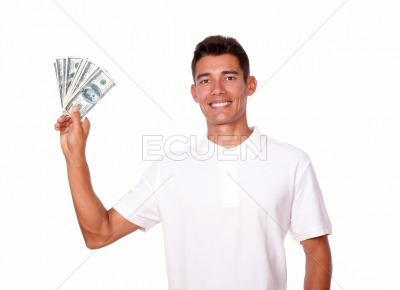 Attractive man is holding money in one hand.