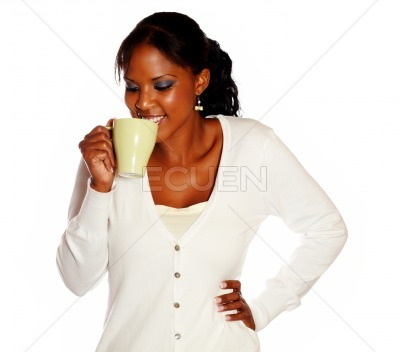 Attractive smiling young female drinking tea mug