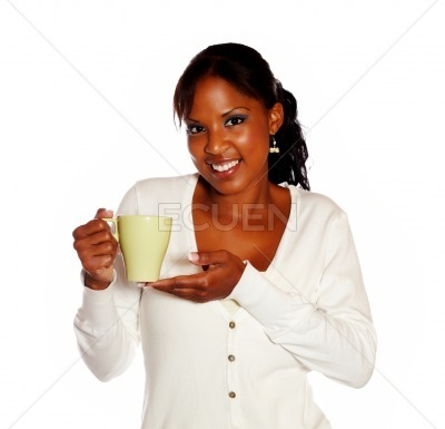 Attractive smiling young female holding a mug