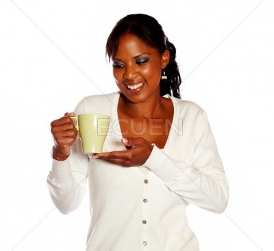 Attractive smiling young woman holding a mug