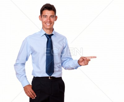 Attractive young man pointing to his left