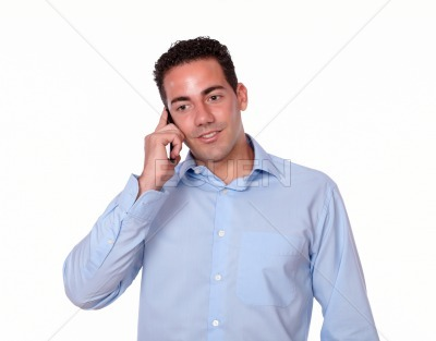 Attractive young man talking on his cellphone
