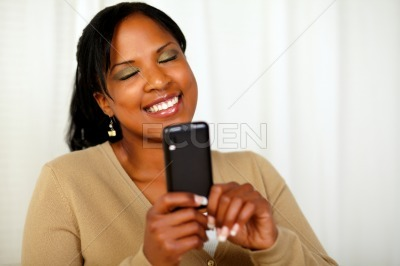 Attractive young woman reading a message on mobile