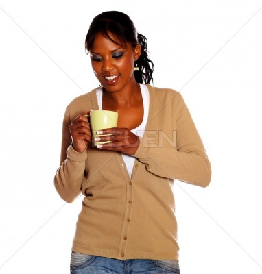 Attractive young woman with a mug