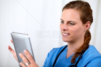 Beautiful blonde doctor woman on blue uniform