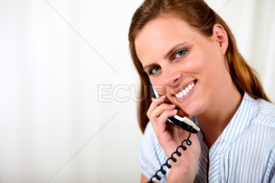 Beautiful blonde girl smiling on the phone