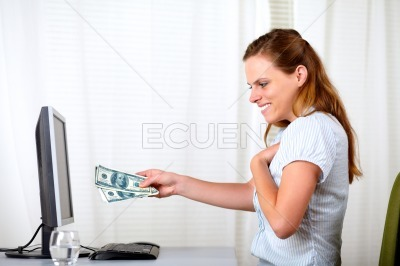 Beautiful blonde girl surprised with money