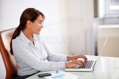 Beautiful manager working with her laptop