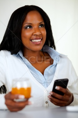 Beautiful woman smiling and using a cellphone