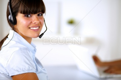 Beautiful young woman wearing a headset