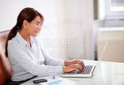 Business lady working with her laptop