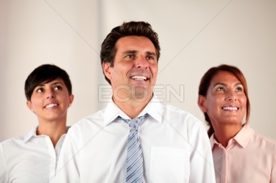 Business team smiling and looking at people