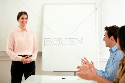 Businessman and businesswoman giving an applause