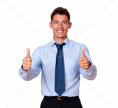 Businessman standing with his thumbs up