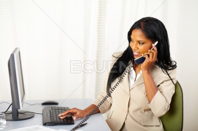 Businesswoman conversing on phone