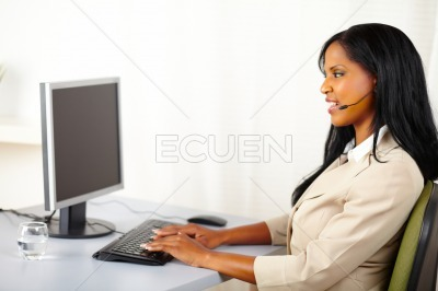 Callcenter operator working on computer