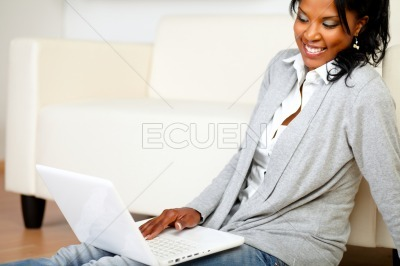 Carefree young woman using her laptop