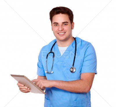 Caucasian male nurse using his tablet pc