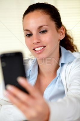 Caucasian woman browsing the internet on cellphone