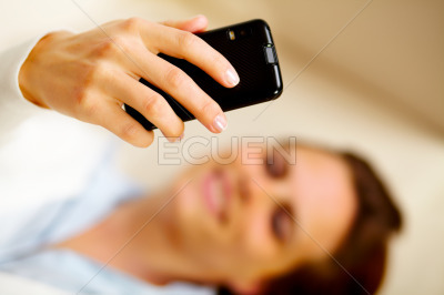 Caucasian woman using a cell phone at home