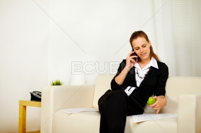 Caucasian young business woman working on sofa