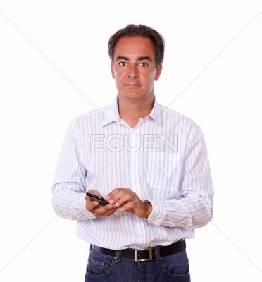Charismatic latin male texting a message