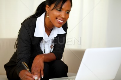 Charming businesswoman on black suit working