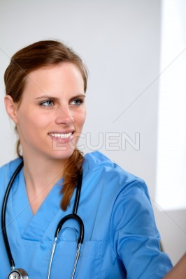 Charming doctor woman looking to a radiograph