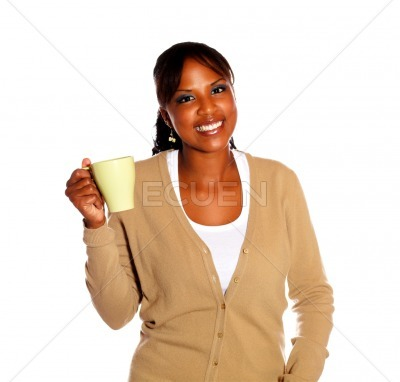 Charming female drinking a mug of coffee