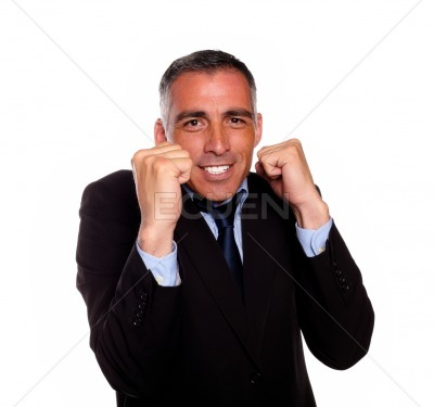 Charming latin businessman boxing