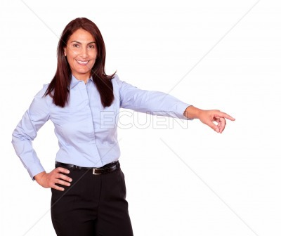 Charming senior woman pointing to her left