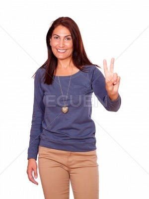 Charming senior woman showing you victory sign