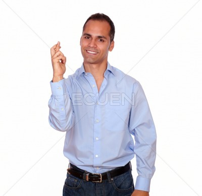 Charming smiling adult man crossing his fingers