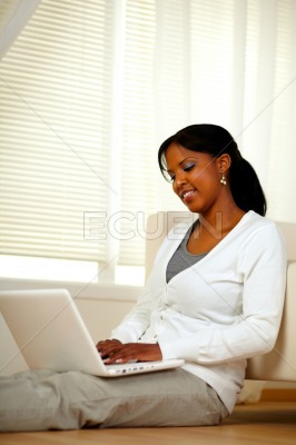 Charming young female working on laptop