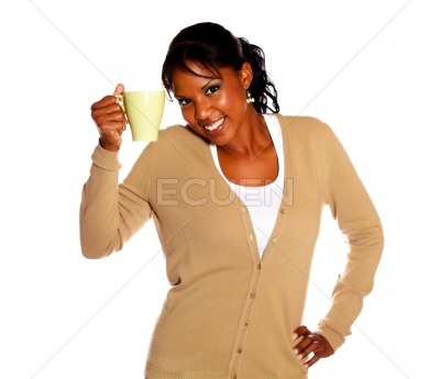 Charming young woman drinking a mug of coffee