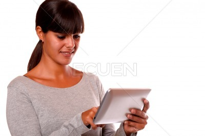 Charming young woman using her tablet pc