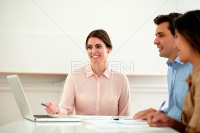 Consultant woman explaining concepts while sitting
