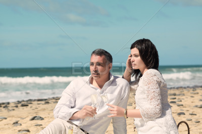 Couple looking to the horizon with glasses
