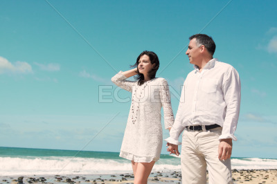 Couple standing at the beach