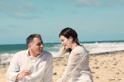 Couples talking and sitting on the beach