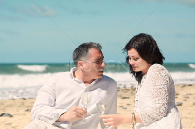 Couples talking with glasses in hand