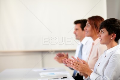 Coworker team giving applause on a conference