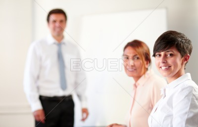 Coworkers during a meeting smiling at you