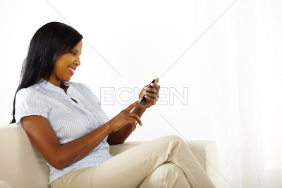 Cute young woman using a mobile phone