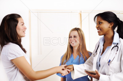 Doctor greeting a patient