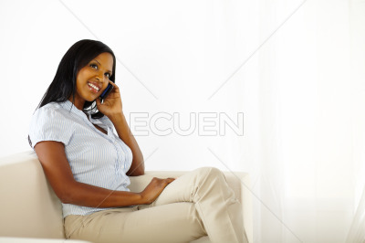 Elegant black young woman on mobile