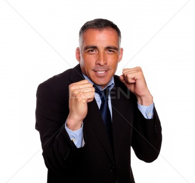 Elegant executive man smiling and boxing