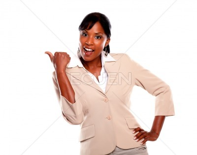 Ethnic businesswoman looking at you pointing left