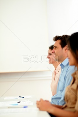 Ethnic colleagues listening to a conference