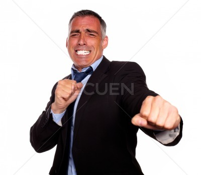 Excited hispanic business man boxing